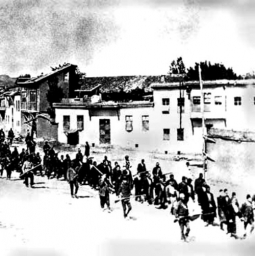 Armenians are marched to a nearby prison in Mezireh by armed Turkish soldiers. Kharpert, Armenia, Ottoman Empire, April, 1915 – Wikipedia/public domain
