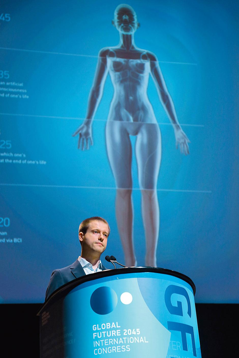 Russian billionaire Dmitry Itskov addresses the Global Future 2045 Congress, June 15, 2013 at Lincoln Center in New York. MARY ALTAFFER/AP