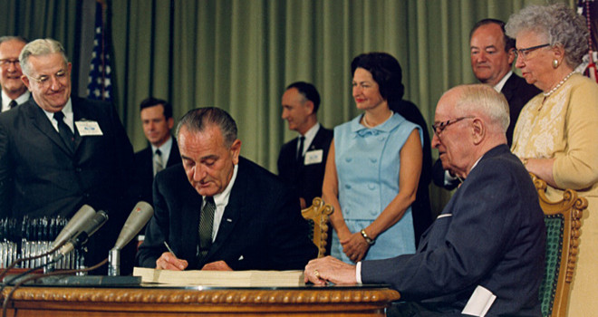 LBJ-signs-Medicare-bill-at-Truman-LIbrary-1965-660x350-1433482917