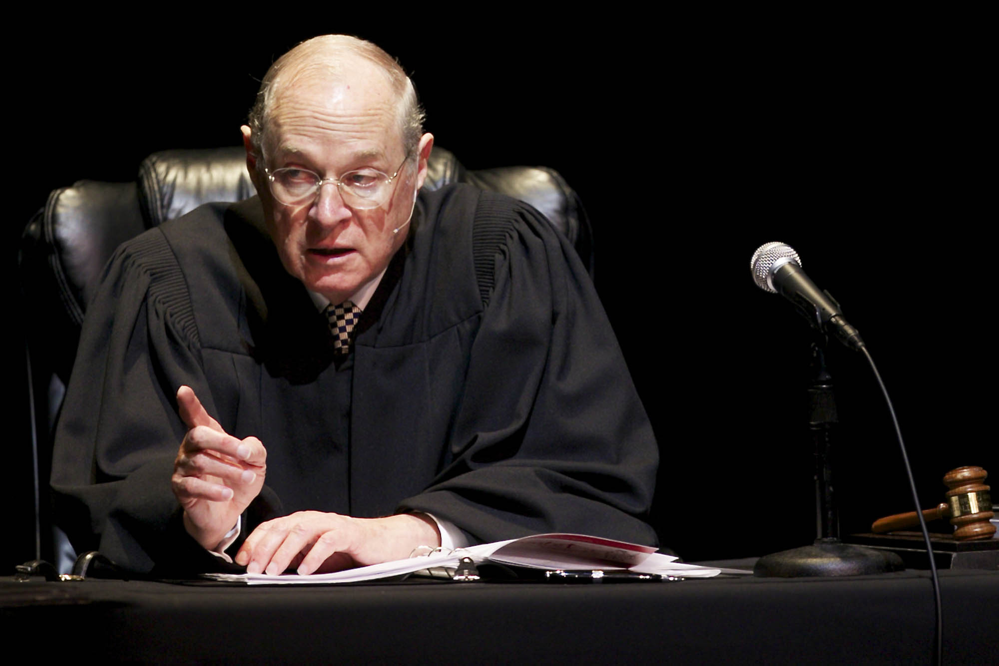 "FILE - In this Jan. 31, 2011, file photo U.S. Supreme Court Justice Anthony Kennedy presides over a representation of ""The Trial of Hamlet"" at the Shakespeare Center of Los Angeles. During Supreme Courts arguments last week over the constitutionality of the health care law Justice Kennedy mused that Congress could have created a Medicare-style program for the uninsured, run exclusively by the government without the involvement of private insurers.  (AP Photo/Damian Dovarganes, File)"