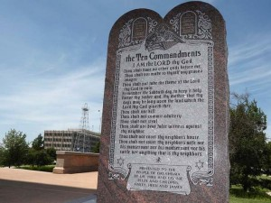FILE - In this June 20, 2014, file photo, shows the Ten Commandments monument at the state Capitol in Oklahoma City. Oklahoma state Rep. Mike Ritze, R-Broken Arrow, whose family paid $10,000 for the monument says he has ordered a new one after someone drove a car across the statehouse lawn and smashed it into pieces. (AP Photo/Sue Ogrocki, File)