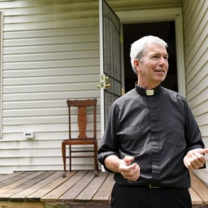 Monsignor Daniel Trapp is leading an effort to renovate abandoned homes near his parish. (Photo: Robin Buckson / The Detroit News)