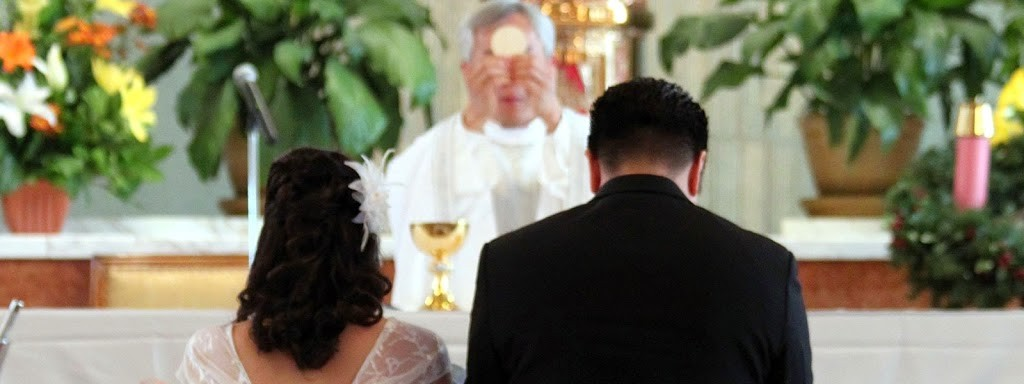 WeddingKneelingBeforeEucharist