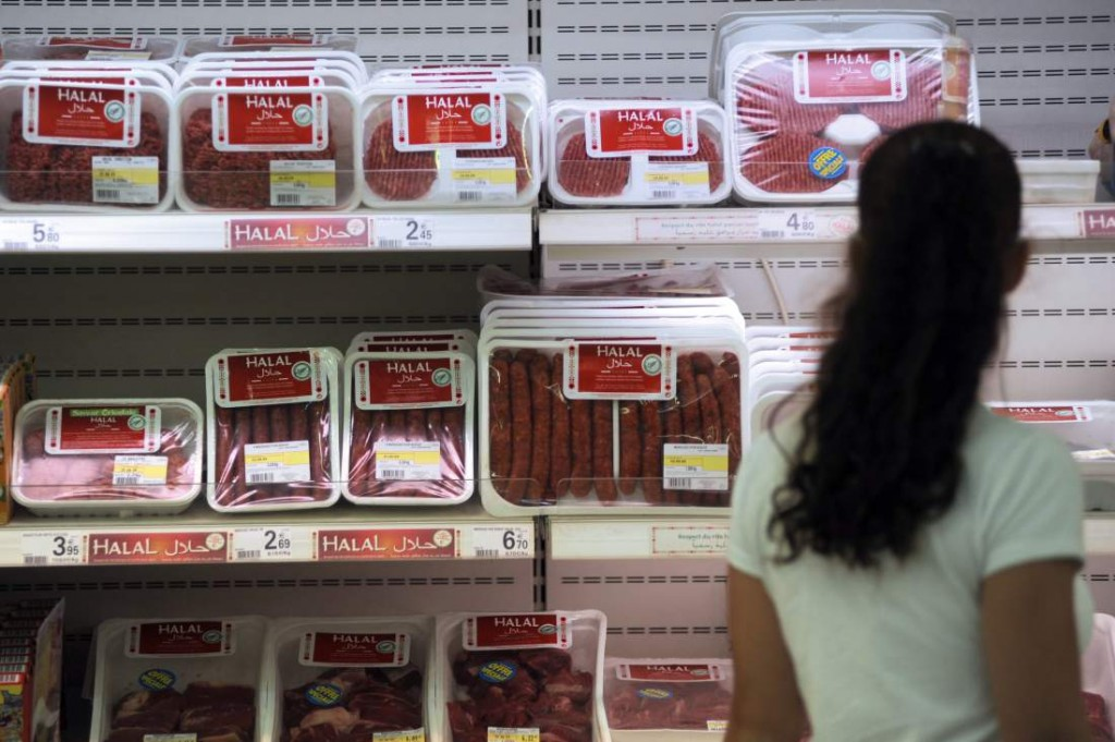 A customer passes by Halal butchery shelves in a supermarket in Illzach, eastern France, on Aug. 21, 2009.