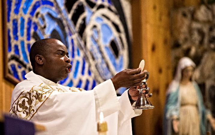 The Rev. Jean Paulin Lockulu celebrated Mass at St. John by the Sea Church in Klawock on Prince of Wales Island in southeastern Alaska in 2014. (Nancy Wiechec/CNS)