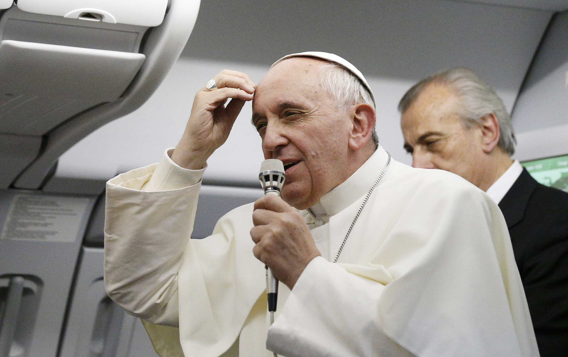 """Pope Francis speaks to the media aboard the papal flight from Rio de Janeiro to Rome July 28. When the pope told reporters, """"Who am I to judge"""" a homosexual person, he was emphasizing a part of Catholic teaching often overlooked by the media and misunderstood by many people. (CNS photo/Paul Haring) (July 31, 2013) See POPE-HOMOSEXUALITY July 31, 2013."""