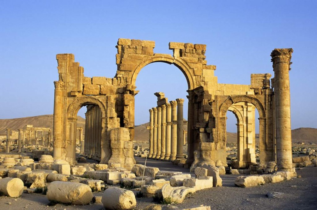 SYRIA - 2001/01/01: Syria, Palmyra, Ancient Roman City, Triumphal Arch And Colonnaded Street. (Photo by Wolfgang Kaehler/LightRocket via Getty Images)