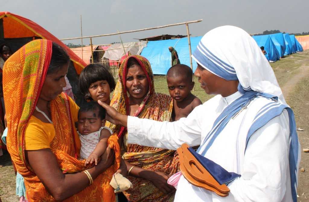 Sister Leo Therese, a member of the Missionaries of Charity, greets Majoni Bibi, holding her child at a refugee camp in early October in Basagaon, India. Bibi, a Muslim refugee forced with her family from their home as fighting erupted in July between tribal Bodos and Muslim settlers in Assam state, praised Catholic relief workers for the donations as her family continues to live in a camp internally displaced people. (CNS photo/Anto Akkara) (Nov. 20, 2012) See INDIA-RELIEF Nov. 20, 2012.