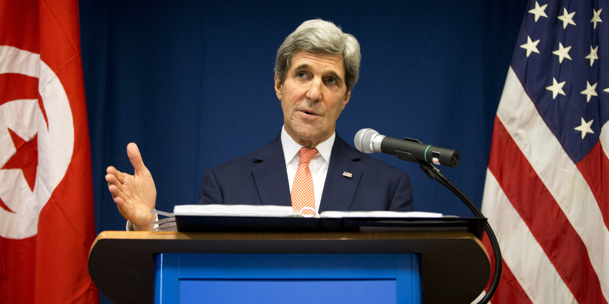 US Secretary of State John Kerry speaks during a news conference at the U.S. Embassy on Tuesday, Feb. 18, 2014, in Tunis.  Kerry promised continued American assistance in the North African nation's battle against terrorists, during his unannounced visit Tuesday. (AP Photo/Evan Vucci)
