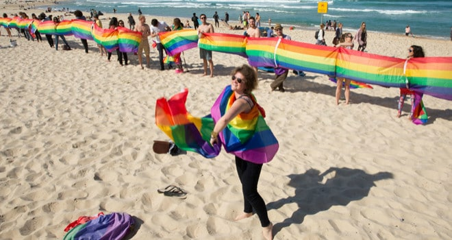 Marriage equality supporters create a rainbow flag to cover the length of Bondi Beach.  .Pictured: Rainbow Flag on Bondi Beach.  Ref: SPL  150815      .Picture by: Mad Max Pepito / Splash News  .    .  Splash News and Pictures    .Los Angeles  .New York  .London    .   (Newscom TagID: spnphotossix538255.jpg) [Photo via Newscom]