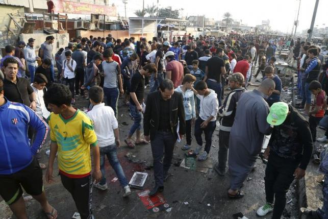 People gather at the site of suicide blasts in Baghdad's Sadr City February 28, 2016. The death toll from two suicide blasts in Baghdad's mainly Shi'ite district of Sadr City rose to 24 with more than 60 others wounded, police and medical sources said on Sunday. REUTERS/Wissm al-Okili