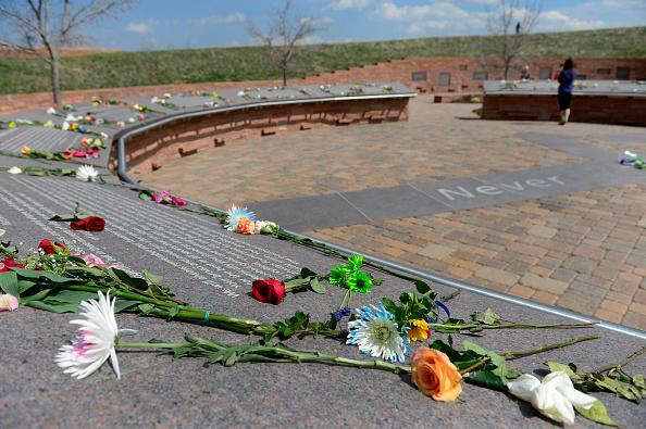 LITTLETON, CO - APRIL 20: Visitors bring flowers and spend time at the Columbine Memorial on Monday, April 20, 2015. Today marks the 16th anniversary of the deadly shooting at Columbine High School which left 12 students and one teacher dead. The school was closed for the day, as it has been every year on this day since the shooting occurred in 1999. (Photo by Kathryn Scott Osler/The Denver Post via Getty Images)