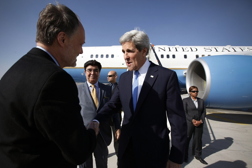 Secretary of State John Kerry, center, shakes hand with James B. Cunningham U.S. Ambassador in Afghanistan in Kabul airport, Afghanistan, on Monday, March 25, 2013. Kerry arrived in Kabul for an official visiting from Afghanistan. (Photo by Musadeq Sadeq/U.S. State Department)