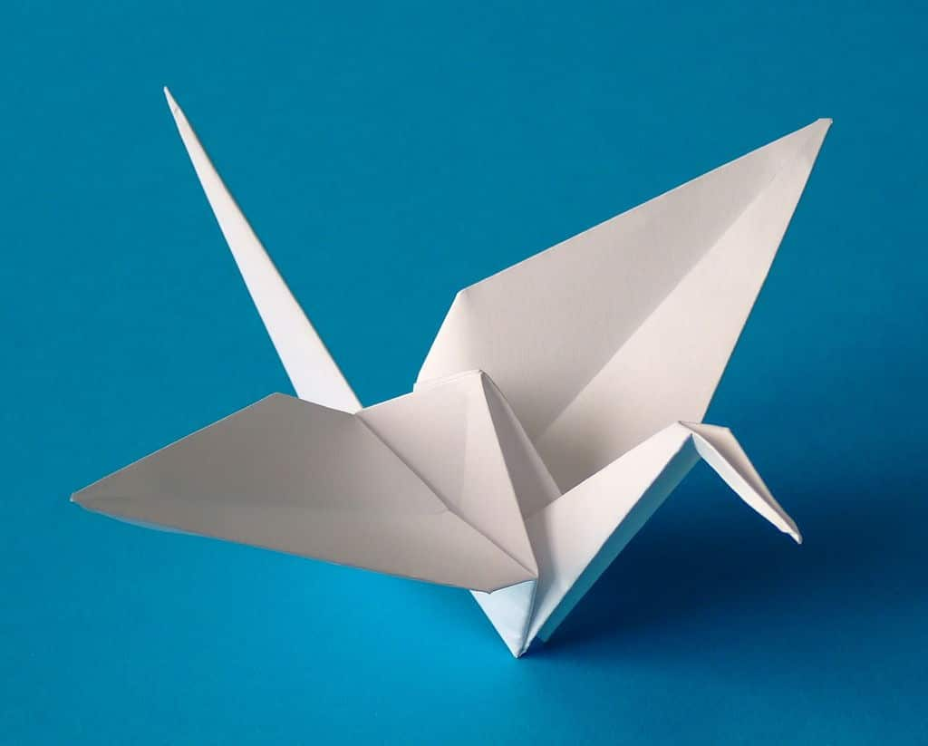 Origami crane folded from one uncut square of paper by Andreas Bauer Origami-Kuns