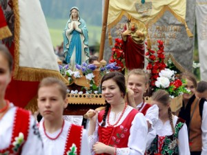 Women dressed in traditional attire take part in a Corpus Christi procession May 26 in Czerwienne, Poland. A eucharistic procession is a traditional feature of the celebration of the feast of the Body and Blood of Christ. (CNS photo/Grezegorz Momot, EPA)
