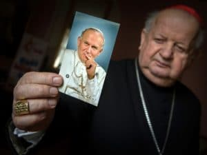Cardinal Stanislaw Dziwisz of Krakow, Poland, held a picture of St. John Paul II at his residence in Krakow March 4 (Credit: CNS/Marcin Mazur)
