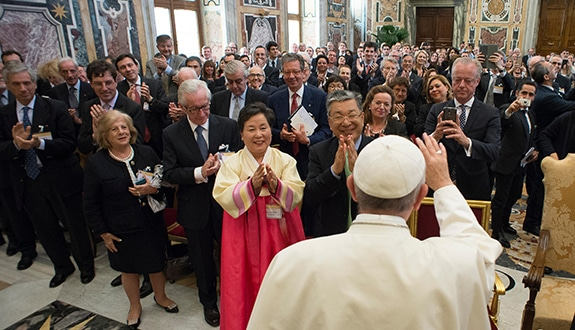 Pope Francis greets business leaders and Catholic social teaching experts during an audience at the Vatican May 13. (CNS photo/L'Osservatore Romano)