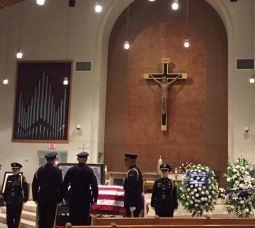 Several thousand friends, Dallas Mayor Mike Rawlings and Police Chief David Brown joined several hundred police officers from Dallas, surrounding cities and across the country in paying their respects to Sgt. Michael Smith on July 12 at Mary Immaculate Catholic Church in Farmers Branch, Texas. – Texas Catholic newspaper Facebook