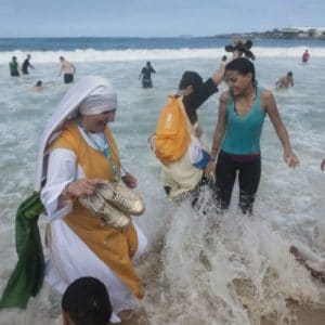 Nuns wade in the sea at Copacabana beach during World Youth Day 2013 (AP Photo/Nicolas Tanner)