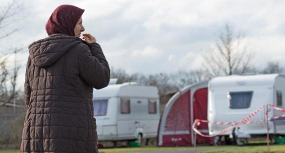 A refugee woman walks through the caravan park in Frankfurt, Germany, Feb. 12. (CNS photo/Alexander Heinl, EPA) See GERMANY-CHRISTIAN-REFUGEES March 10, 2016.